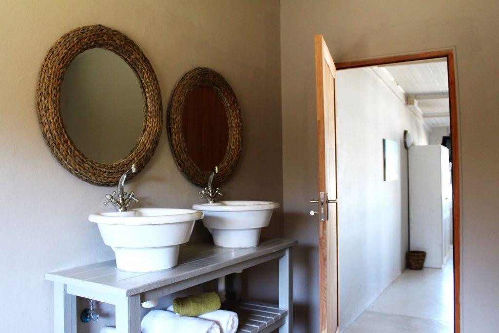 Bathroom with freestanding basins at Plett River Lodge