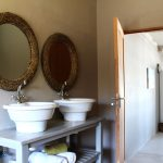 Bathroom with freestanding basins at Plett River Lodge