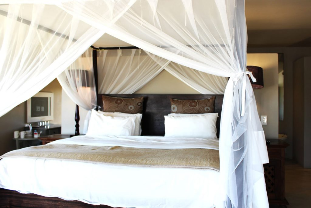 Four poster bed in room at Plett River Lodge