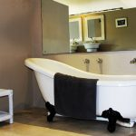 Freestanding bath in room at Plett River Lodge